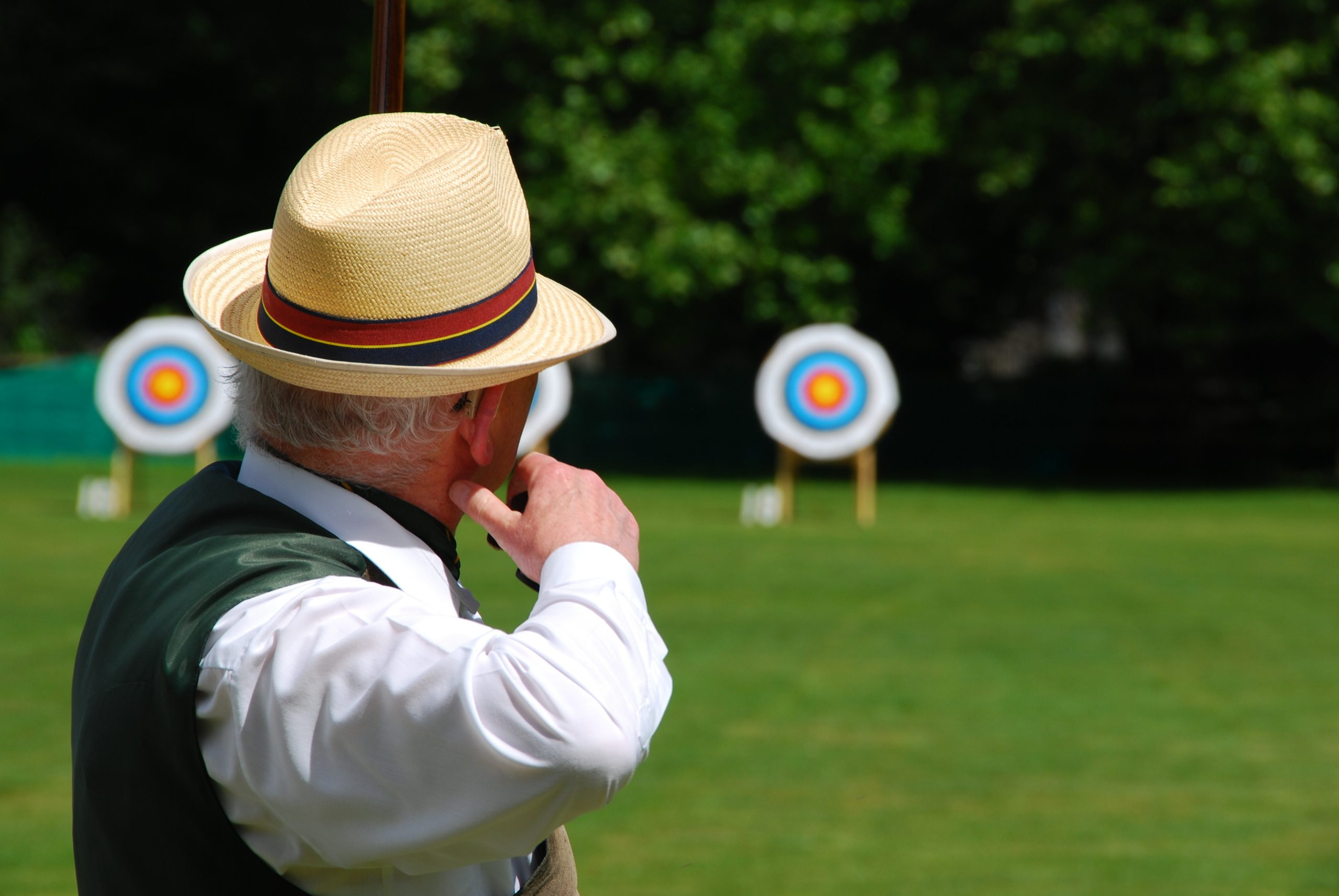 A senior archer hitting the target, Shutterstock